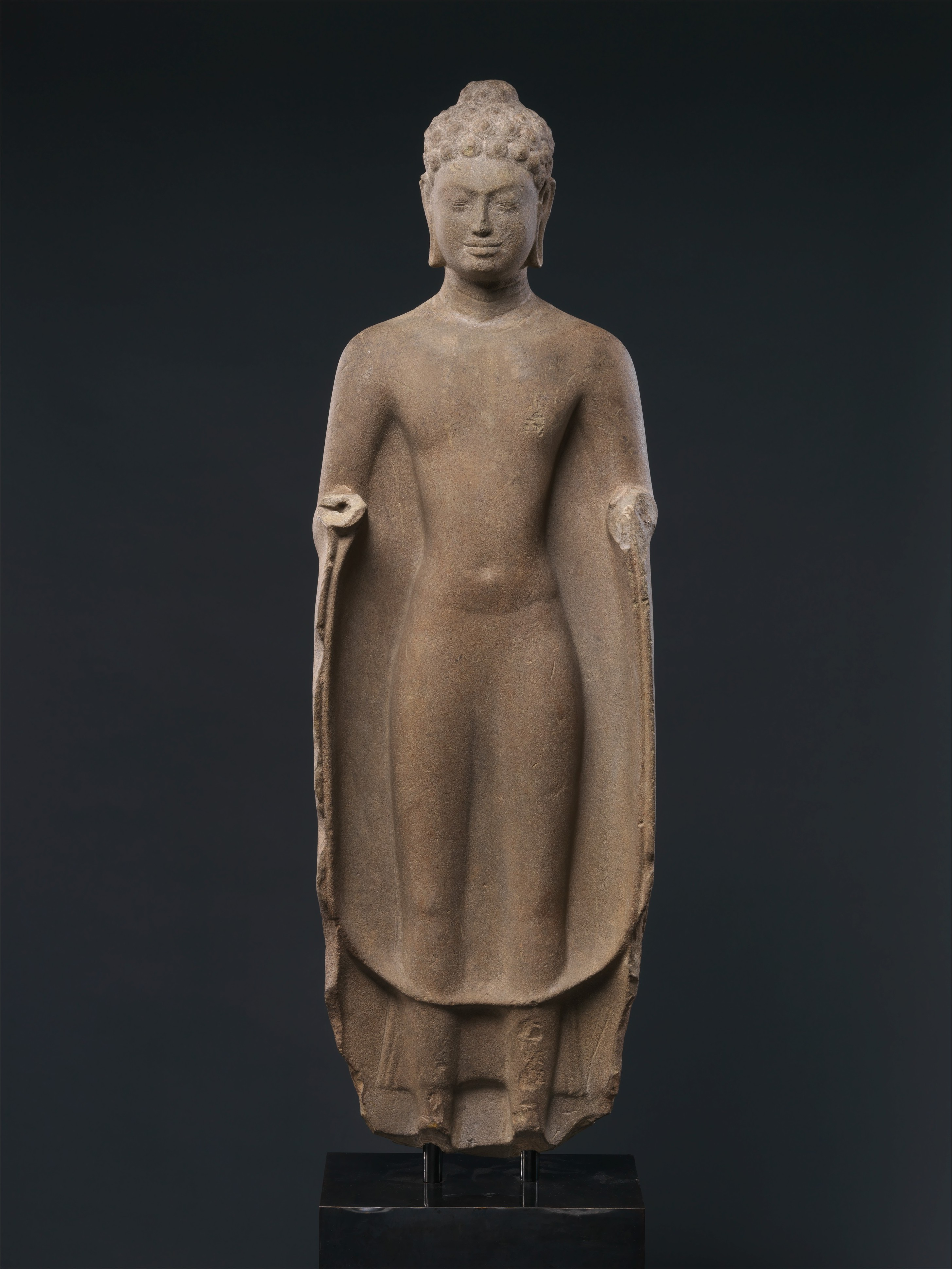 Standing Buddha, ca. first half of the 7th century Cambodia, pre-Angkor period Stone; H. 39 1/2 in. (100.3 cm); W. 12 in. (30.5 cm); D. 4 1/4 in. (10.8 cm) The Metropolitan Museum of Art, New York, Gift of Florence and Herbert Irving, 1993 (1993.477.3) http://www.metmuseum.org/Collections/search-the-collections/38160