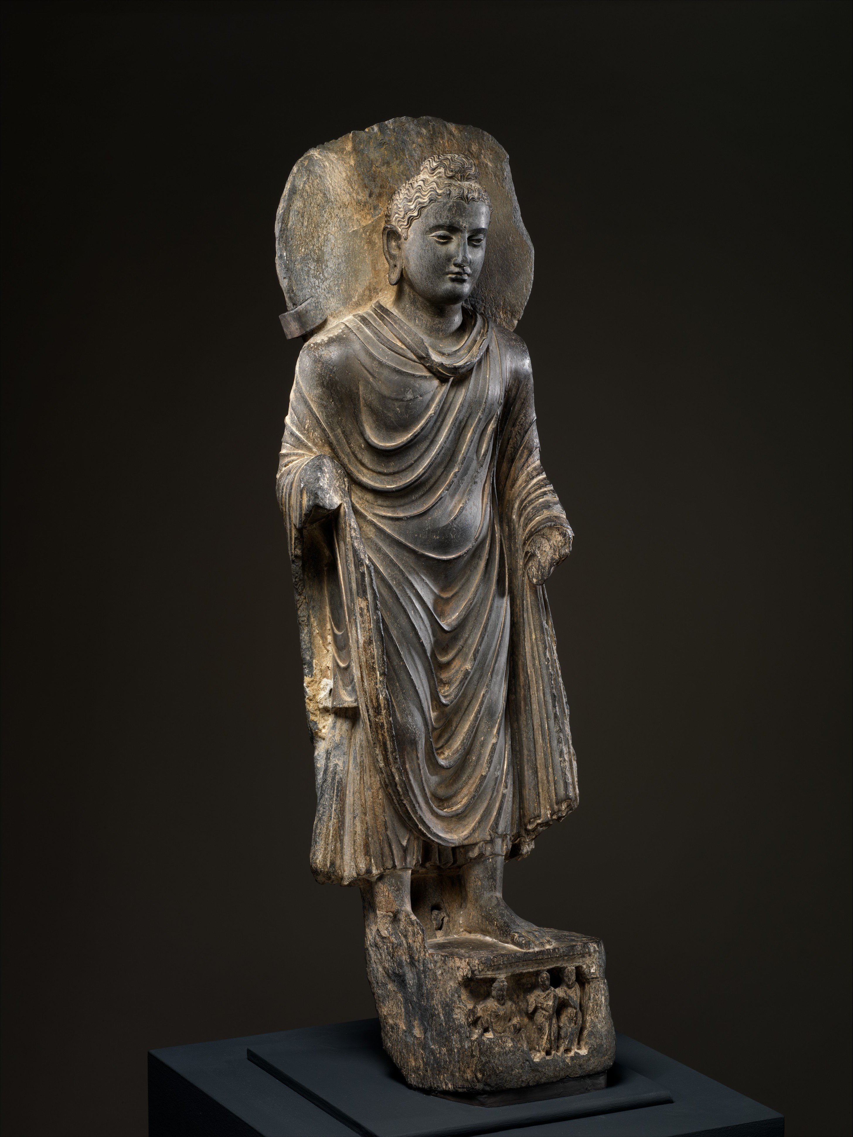 Buddha, 3rd century Pakistan, Khyber-Pakhtunkhwa province, Schist; H. 36 1/2 in. (92.7 cm); W. 11 in. (27.9 cm); D. 5 1/2 in. (14 cm) The Metropolitan Museum of Art, New York, Purchase, Denise and Andrew Saul Gift, in honor of Maxwell K. Hearn, 2014 (2014.188) http://www.metmuseum.org/Collections/search-the-collections/646117